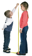 This photo is of a child measuring the height of another child.