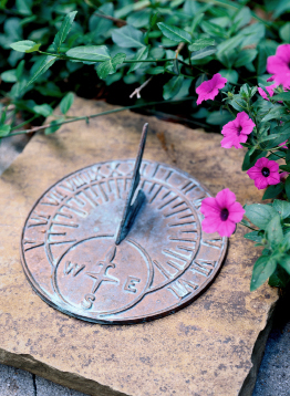 This photo shows a sundial on a pedestal.
