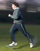 This photo shows a runner who averages jogging a mile in 10 minutes.