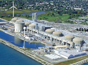 This picture of a nuclear power plant was taken from a plane. The plant consists of 8 large dome-shaped reactor buildings and other structures.